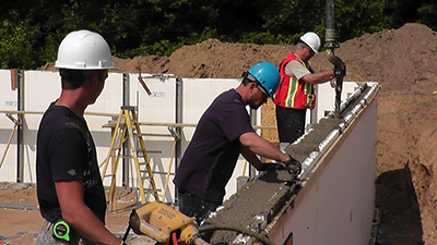 Pouring and vibrating concrete is the last step in construction your walls using ICFs