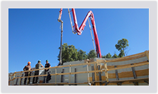 When pouring concrete for tall walls, a pump truck is used to deliver the concrete into the Advantage ICFs